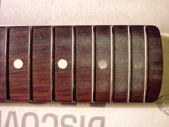 the highest frets get ground the most