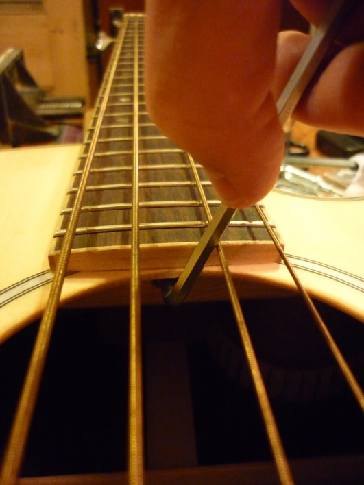 Adjusting an acoustic bass truss rod